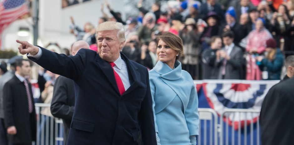 President Trump points at the crowd as he walks pass the inaugural parade reviewing stand in the 58th Presidential Inaugural parade in Washington D.C., January 20, 2017. U.S. Armed Forces personnel provide ceremonial support to the 58th Presidential Inaugural during the Inaugural period. This support comprises musical units, marching elements, color guards, salute batteries, and honor cordons, which render appropriate ceremonial honors to the Commander-In-Chief. (U.S. Army photo by Pvt. Gabriel Silva)