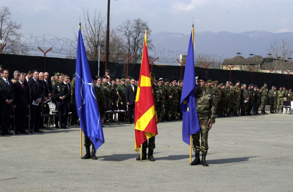 Ceremony held in Skopje on 31 March 2003 which marked the end of NATO's peacekeeping mission in the former Yugoslav Republic of Macedonia; Photo: NATO